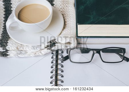 Coffee Cup with Book and on The Scarf in Winter Season with Vintage Tone