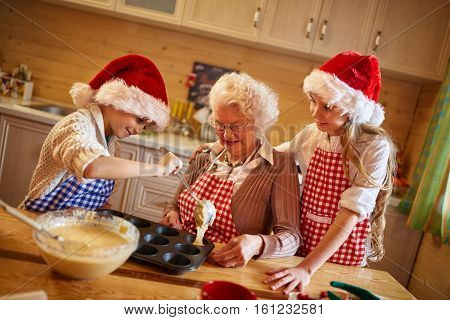 Baking cookies with grandmother on Christmas time