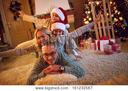 happy family in Christmas atmosphere on Christmas eve
