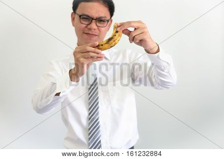 Portrait of young asian ceo businessman thinking with banana idea concept.