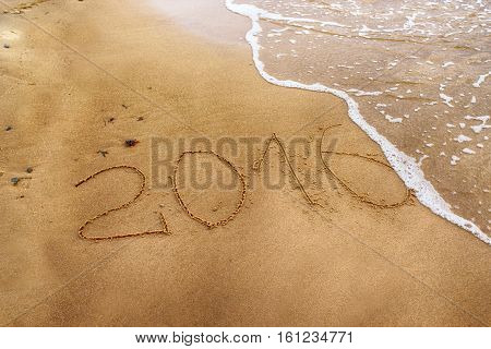 New year number 2016 drawing on the sand