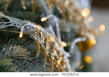 light from the garlands. Christmas tree decorated ball close-up