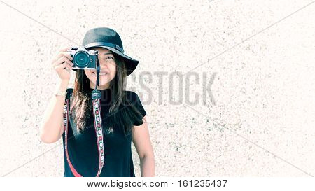 Asian butiful woman with camera. Hipster fashion photographer vintage tone.