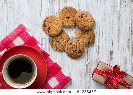Cup of coffee and cookies on rustic wooden table