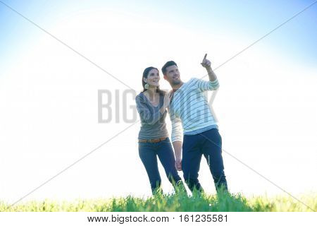 Couple walking in countryside on sunny fall day