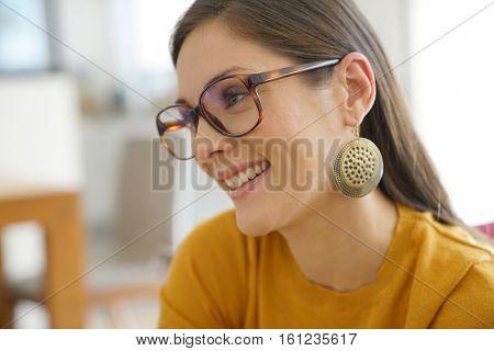 Portrait of smiling brunette girl with eyeglasses