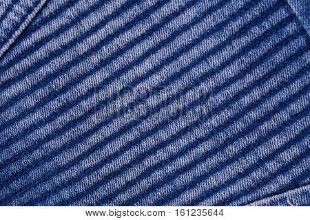 Texture of blue jeans textile