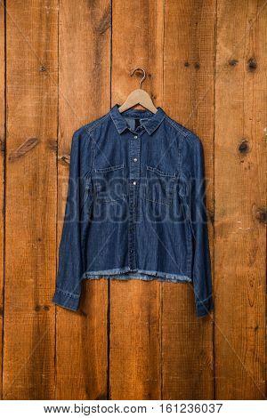 Denim jacket on wooden background