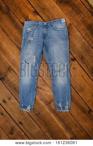 blue denim jean on wood background