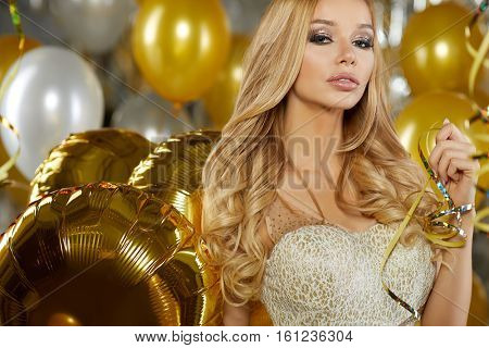 Beauty woman in gold dress. New Year concept