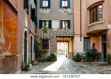 VENICE, ITALY - September 20, 2016.Traditional street view of old buildings in Venice on May 26, 2015. its entirety is listed as a World Heritage Site, along with its lagoon.September 20 VENICE, ITALY