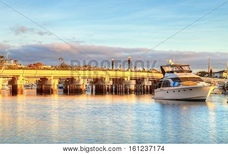Bridge from Jamboree Road onto Balboa Island decorated for Christmas holiday season in Southern California, USA