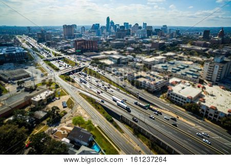 Tilt Shift Austin Texas Aerial Over Interstate 35 the main highway in and out of Central Texas Skyline Cityscape background with Texas State Capitol on the right