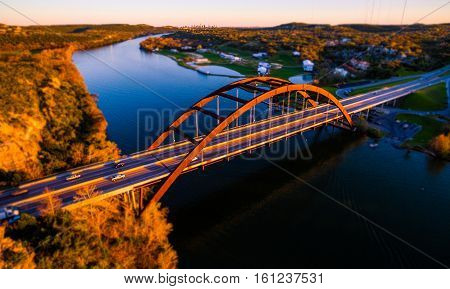 Tilt Shift Pennybacker Bridge Sunset over Austin Texas USA landmark Suspension Bridge over Colorado River at Town Lake during Autumn Fall Colors