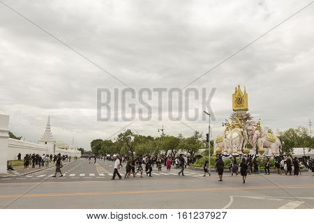 BANGKOK THAILAND - NOV 13 : mourners on Ratchadamnoen Nai road in sanam luang area while the funeral of king Bhumibol Adulyadej in Grand Palace on november 13 2016
