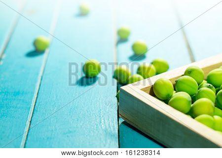 Lotus seeds in wooden frame on light blue wooden background