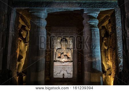 AJanta caves, India - March 3, 2016: Statue of Buddha in Ajanta caves near Aurangabad, Maharashtra state in India