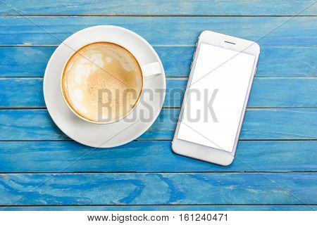 Top View Empty White Coffee Cup (latte Coffee) And Smartphone With Blank Screen On Blue Vintage Wood