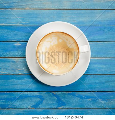 Top View Empty White Coffee Cup (latte Coffee) On Blue Vintage Wooden Table