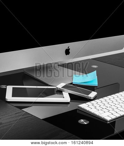 UKRAINE, RIVNE, NOVEMBER 2, 2016. Apple Computer iMac 27 retina display 5K keyboard and magic mouse on black table. isolated on a white background