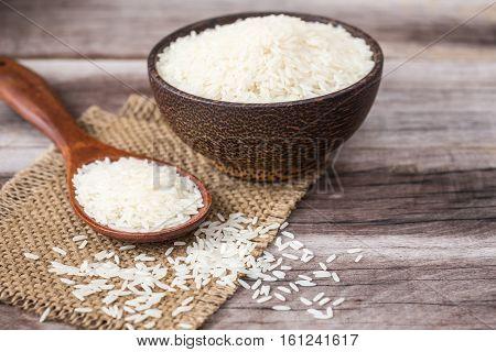 White Thai Jasmine Rice On Wooden Plank