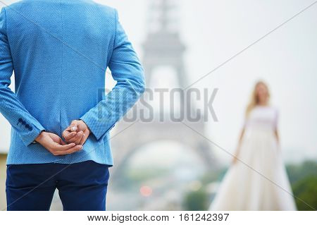 Groom Hiding The Wedding Ring Behind His Back