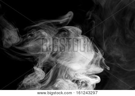 Abstract smoke Vape. Personal vaporizers fragrant steam. The concept of alternative non-nicotine smoking. White smoke on a black background. E-cigarette. Evaporator. Taking Close-up. Vaping.