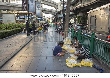 BANGKOKTHAILAND - NOV 26 : garland seller near Erawan shrine at Ratchaprasong Junction in morning on november 26 2016. Erawan shrine is famously sacred place in bangkok