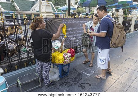BANGKOKTHAILAND - NOV 26 : selling of garland stall outside Erawan shrine at Ratchaprasong Junction on november 26 2016. Erawan shrine is famously sacred place in bangkok