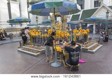 BANGKOKTHAILAND - NOV 26 : Unidentified tourist pray to Erawan shrine at Ratchaprasong Junction on november 26 2016 Thailand. Erawan shrine is famously sacred place in bangkok