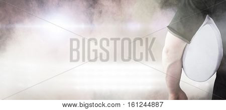3D Rugby player holding a rugby ball against splashing of color powder
