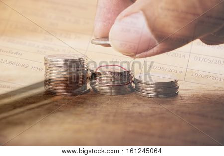Double exposure hand with stack of coins and utility bill with account banking for finance Money and finance concept