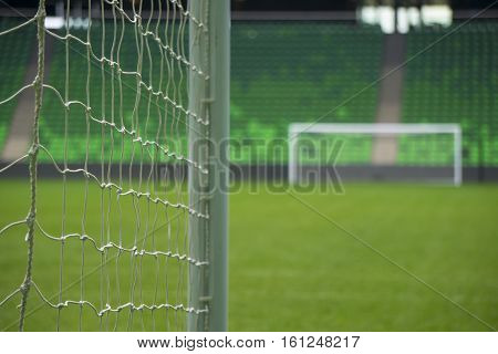 Soccer football goal through the net. Games in Russia.