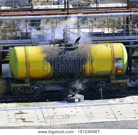 train transports tanks with oil and fuel after draining the purified steam