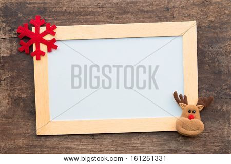 Christmas Gift Box And Whiteboard On Wood Background.