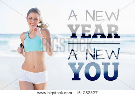 New year new you against sporty blonde jogging on the beach