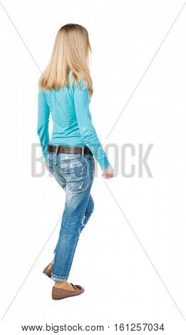 back view of walking  woman. beautiful girl in motion.  backside view of person.  Rear view people collection. Isolated over white background. girl in a blue jacket passes us.