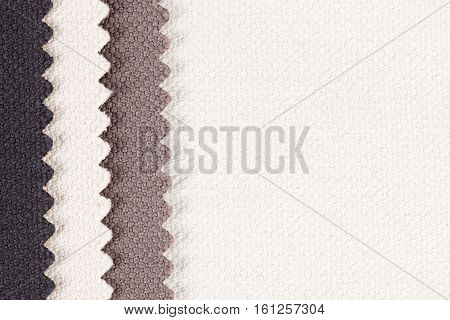 Composition of colored vertical stripes of serrated cotton fabric. place for text