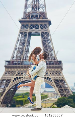 Romantic Loving Couple Having A Date Near The Eiffel Tower