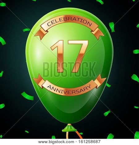 Green balloon with golden inscription seventeen years anniversary celebration and golden ribbons, confetti on black background. Vector illustration