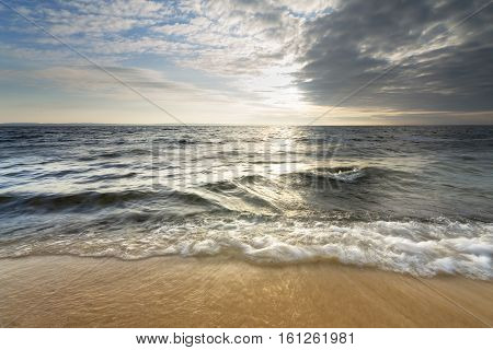 sandy beach after sunrise / bright spring landscape