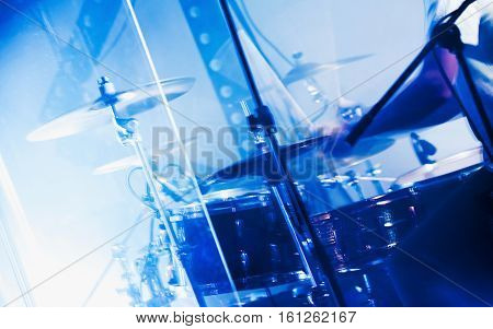 Drum Set Behind Glass Wall With Cymbals