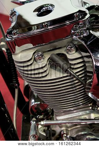 Closeup of a motorcycle engine and attachments.