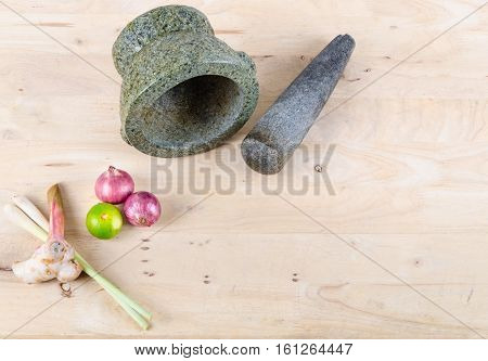 Thai spice  (lemon grass, galangal, shallots and lemon ) with stone mortar and pestle. Template / background for Thai food and spice product.