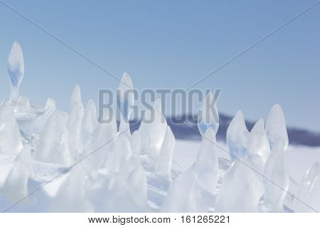 Ice floe on background winter sunny landscape. Winter backdrop.