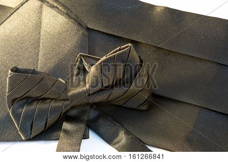 Black bow tie with a sash and a handkerchief for a suit for the evening ball