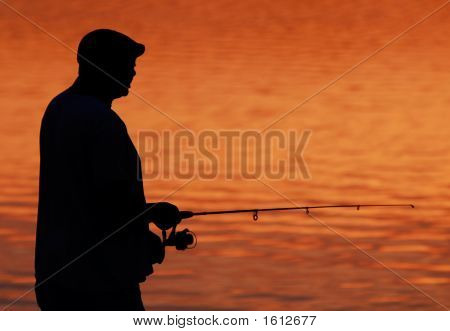 Fishing Silhouette At Sunset