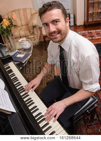 Portrait Of Music Performer Playing His Piano