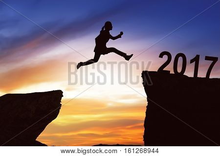 Woman Jumping On The Hill Toward 2017
