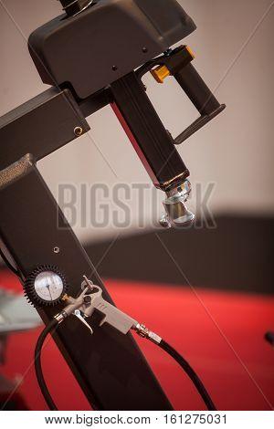 Close up shot of a tire changing machine.